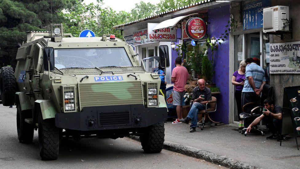 A Georgian police car patrols the streets of Tbilisi, June 2020