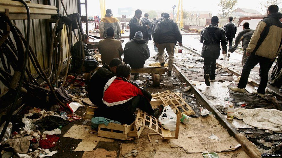 Men in squalid living conditions