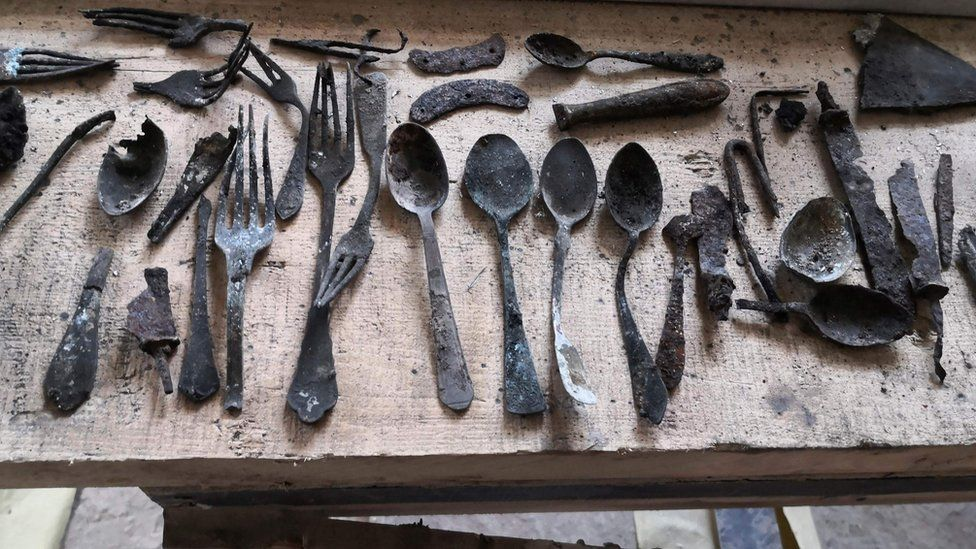Objects found by renovators under a chimney in Block 17 at Auschwitz