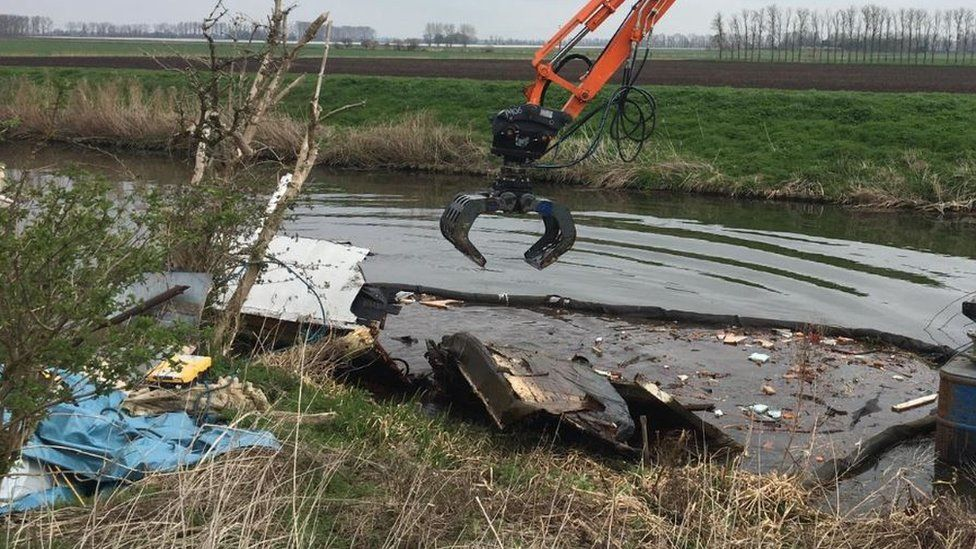 Wreckage of boat in river