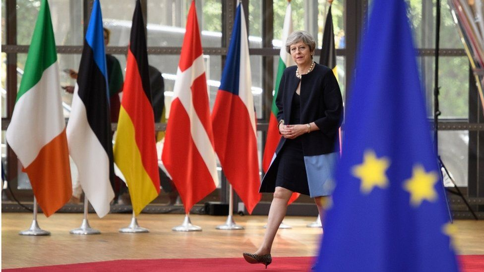 Theresa May arrives at Brussels summit