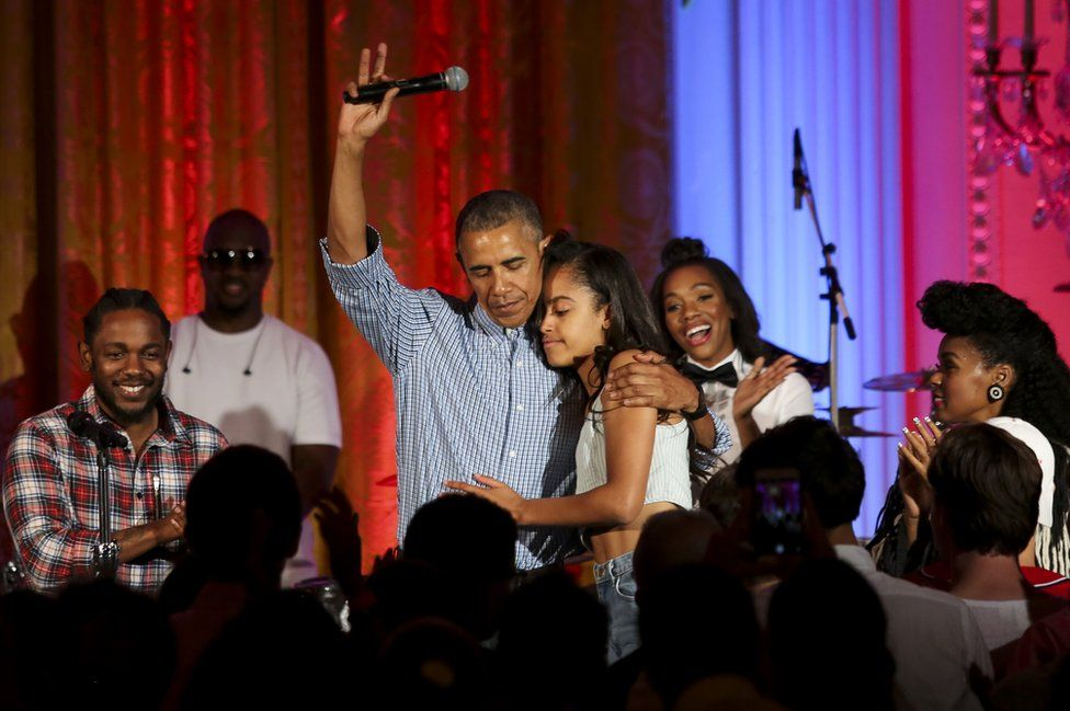 President Barack Obama hugs his daughter Malia Obama at the Fourth of July White House party on July 4, 2016 in Washington, DC. Guests including singers Janelle Monae and Kendrick Lamar.