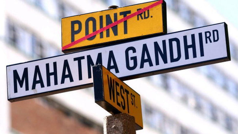 South African seaside city grapples with name changes A street sign on the old 'Point Road and West Street' is replaced by the new 'Mahatma Gandhi Road' in central Durban 06 May 2007.