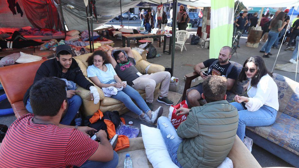 People sit down at an anti-government protest camp in the centre of Beirut, Lebanon (30 October 2019)