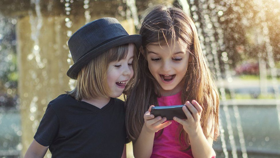 Children on a phone