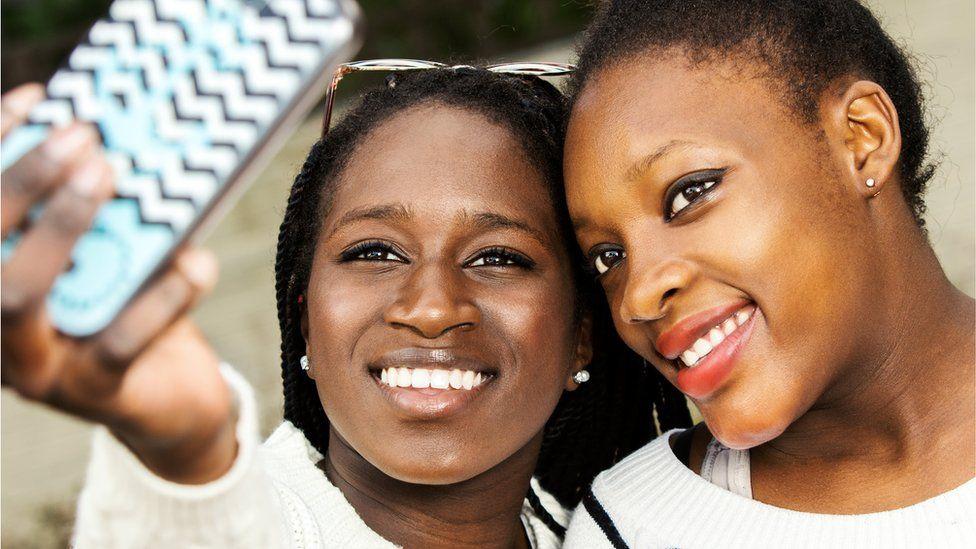 Two African teenage girls taking a selfie
