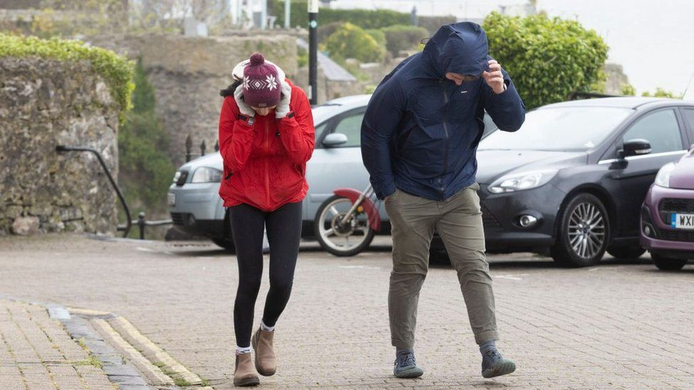 People in strong winds in Tenby