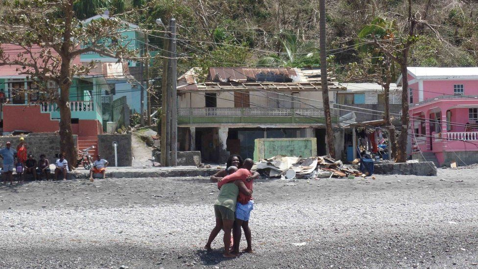 Glen Hector is greeted by his mother and sister upon arriving home in Scott's Head loaded with supplies from Antigua