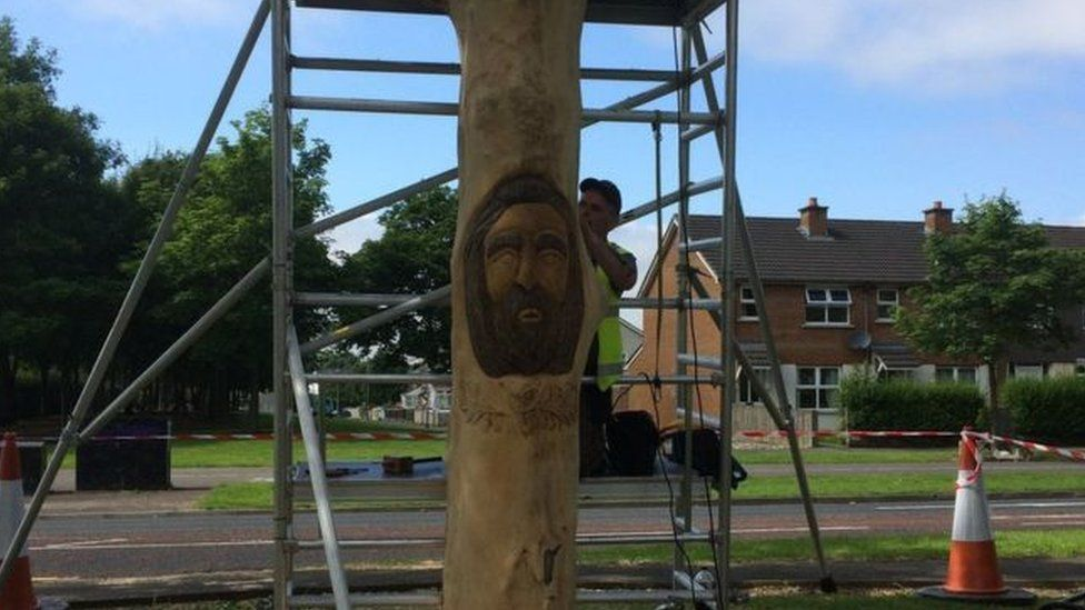 Sculptor carving wood featuring image of Celtic demigod Bran Mac Feabhail