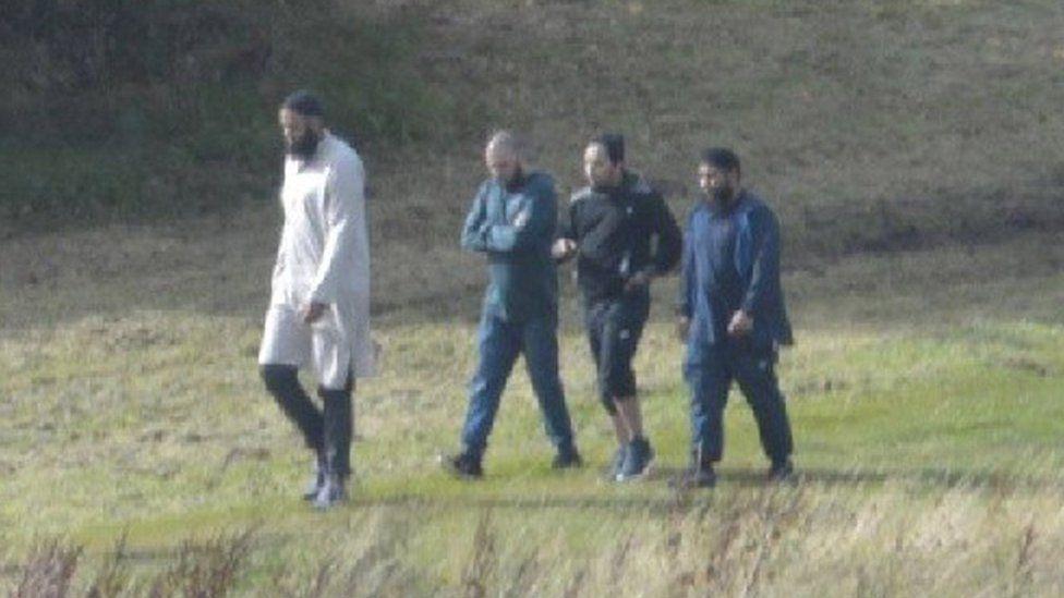 Convert photo of the four men meeting