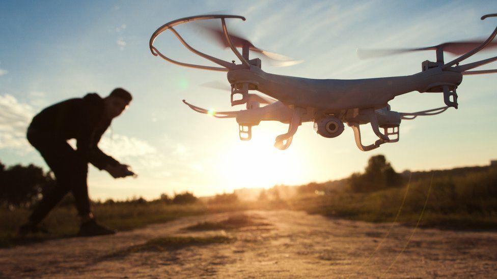 Man launching a drone