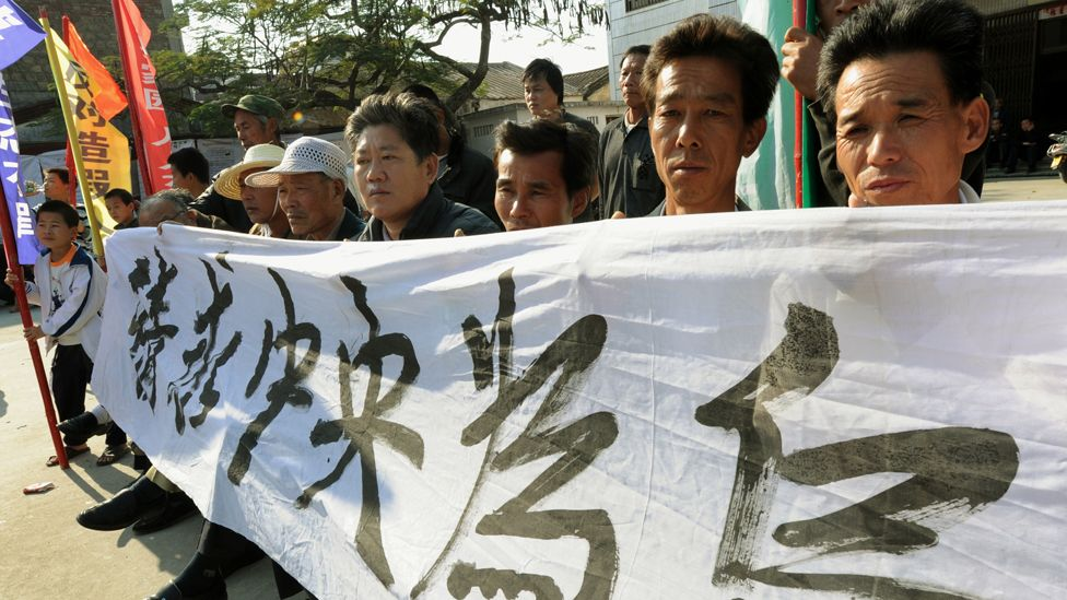 Villagers protest in the southern province of Guangdong, after the death in custody of a local leader on 19 December, 2011