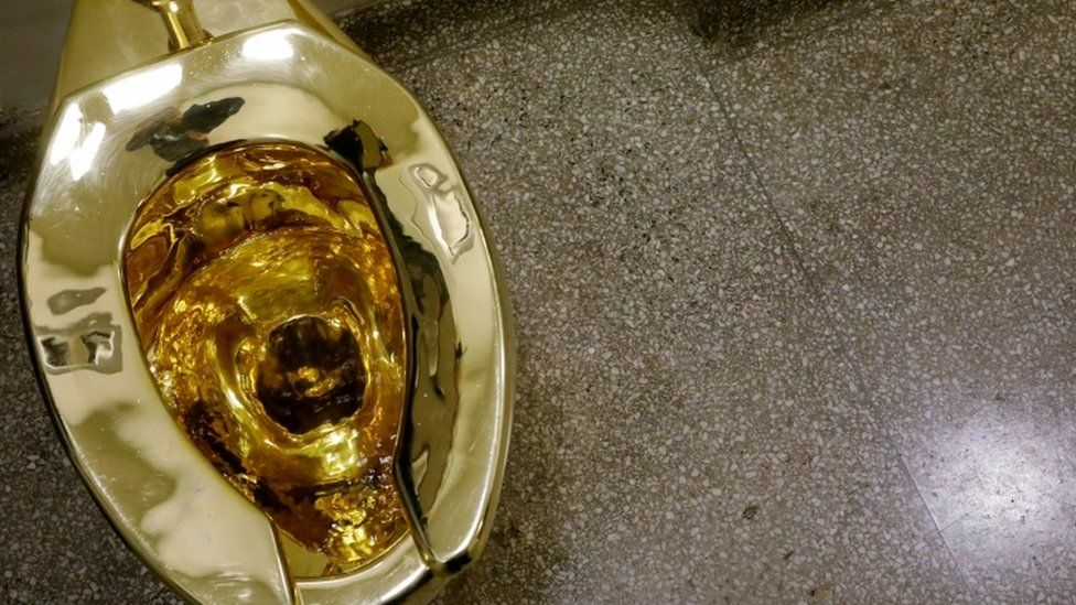 The fully functioning solid gold toilet created by Italian artist Maurizio Cattelan