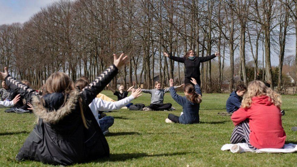 Rebekka Hjorth holds a music lesson outdoors with her class at the Korshoejskolen school on 15 April