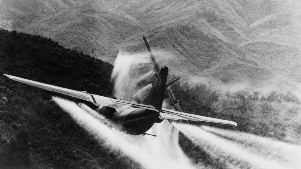 US air force jet flies over an area near Saigon spraying Agent Orange in 1968