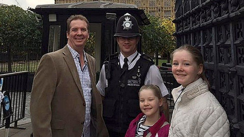 Handout photo of Australian Andrew Thorogood, 41, and daughters Alexsandra, 12, and Georgia, 9, with Pc Keith Palmer