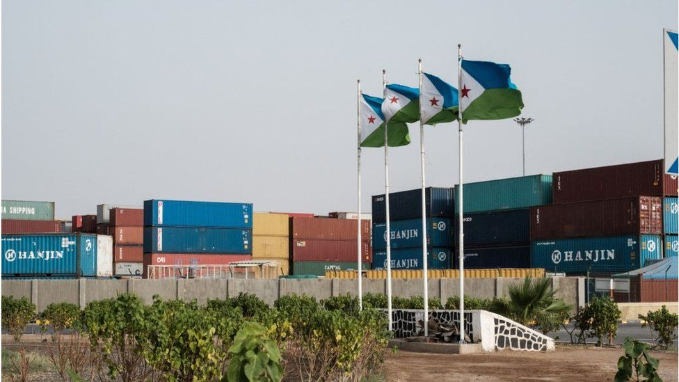 Djibouti's national flags at the Doraleh port
