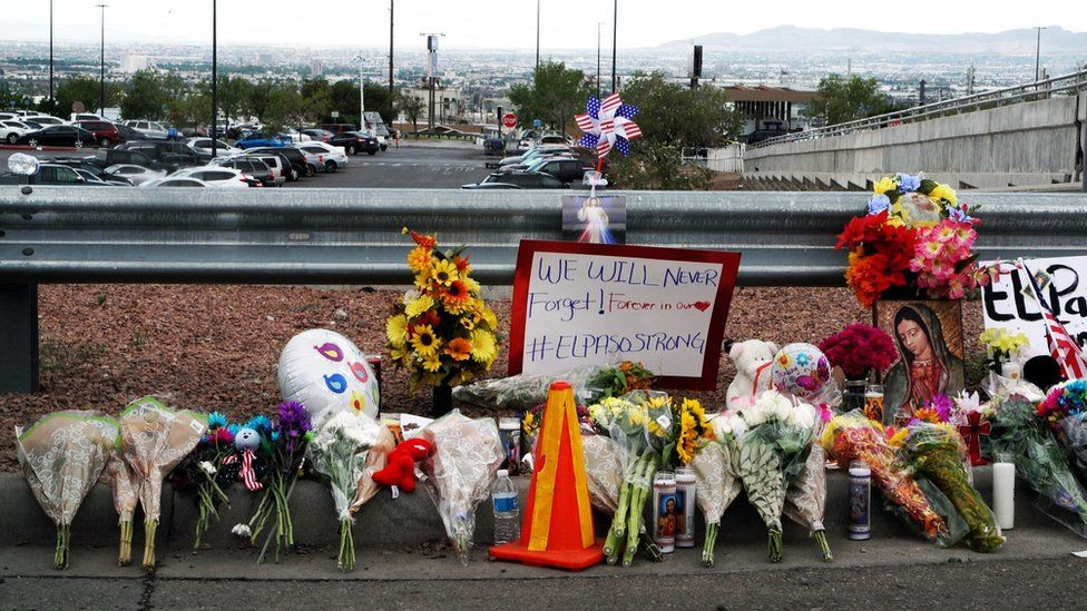 Signs and flowers left at a site nearby to where the shooting took place