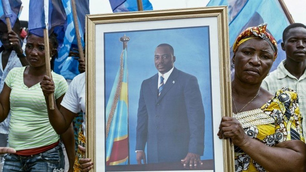 "Civilians gather as they listen to the Democratic Republic of Congo""s President Joseph Kabila addressing the nation outside Palais du Peuple in the capital Kinshasa"
