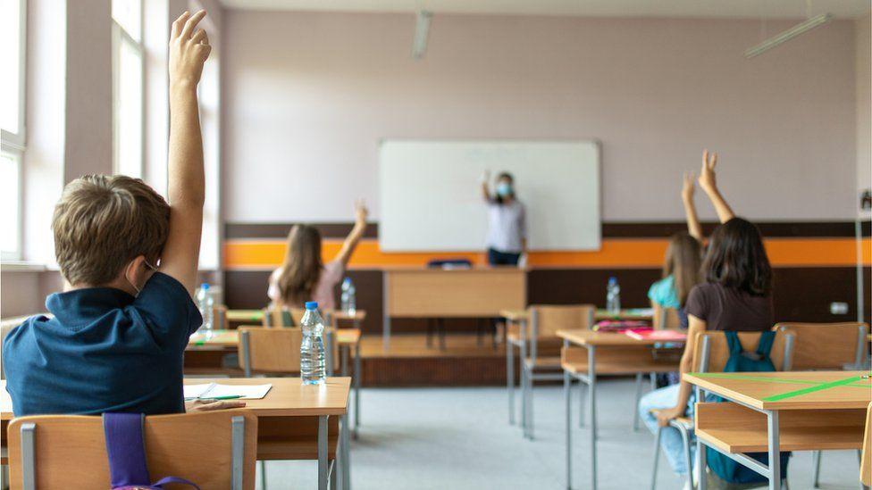 pupils in class covid teacher in mask