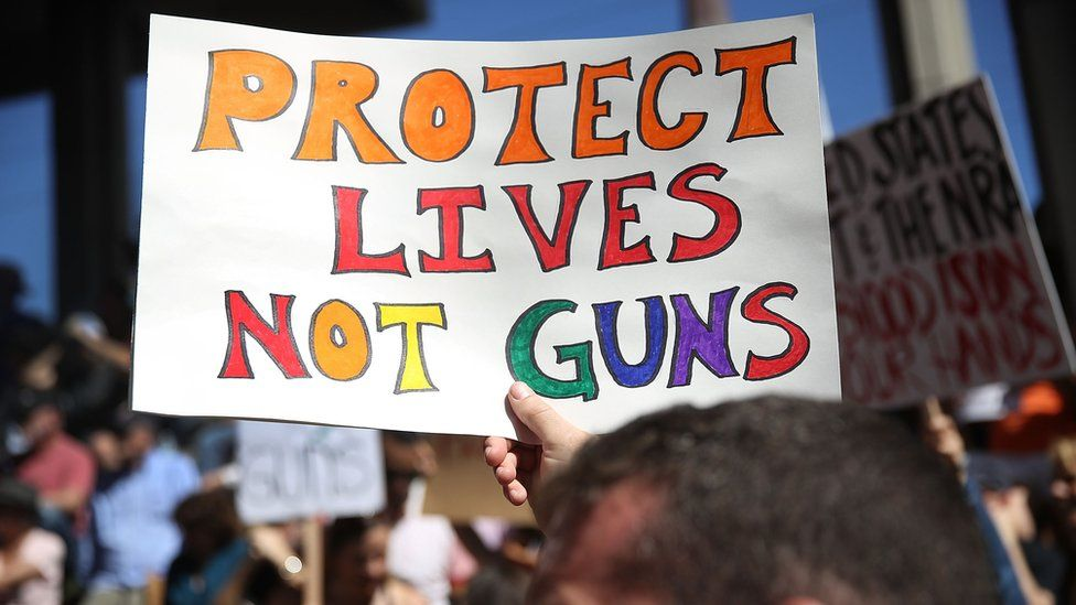 A sign protesting gun violence in the US