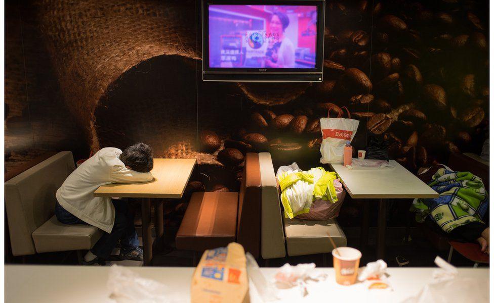 People sleeping in McDonalds