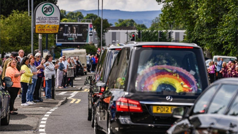 The funeral cortege passed St Catherine's Primary School, where the two boys were pupils