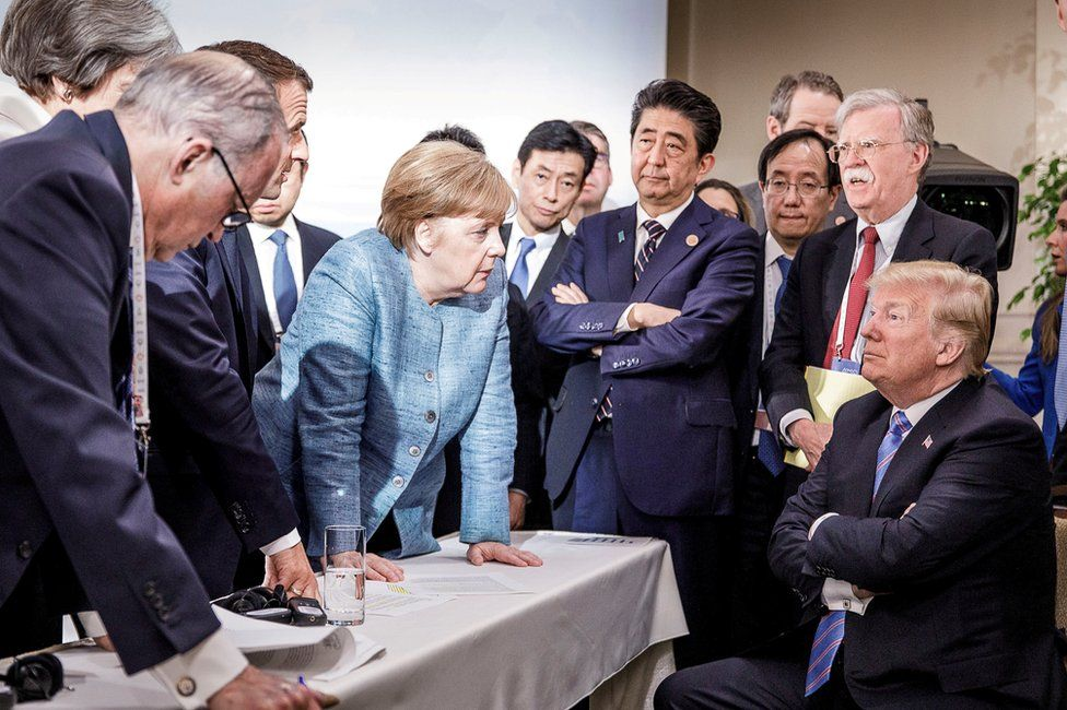 German Chancellor Angela Merkel speaks to U.S. President Donald Trump during the second day of the G7 meeting in Charlevoix city of La Malbaie, Quebec, Canada, June 9, 2018