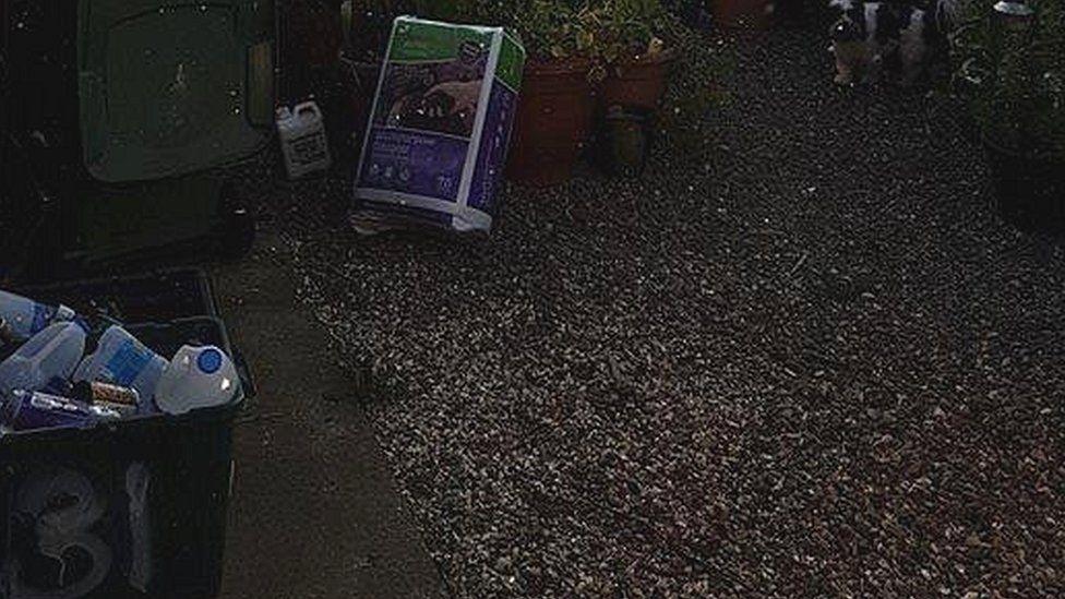 Dust from Kronospan left in a garden