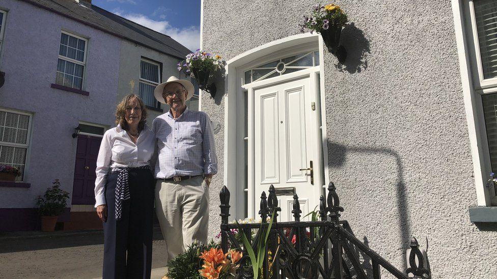 Mauree and Jim Nelis outside their house.