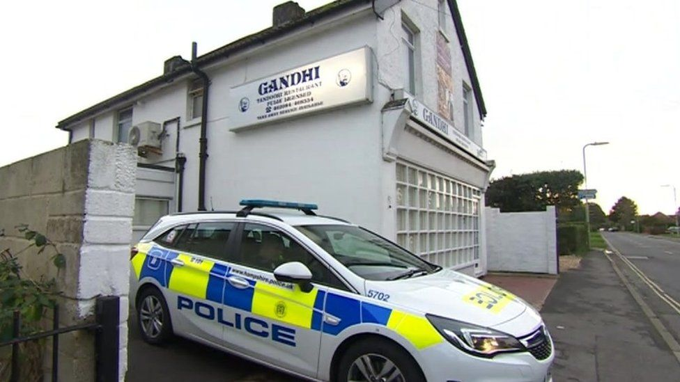 Police car outside Gandhi restaurant