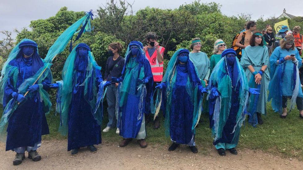 Extinction Rebellion protesters in blue