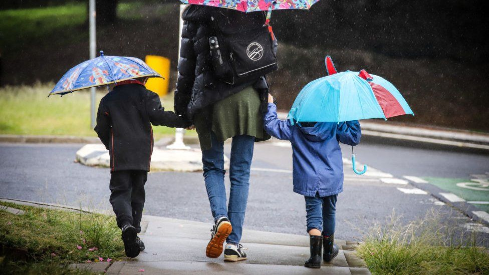 Mother and two kids walk to school in the suburb of Bondi on 25 May 2020 in Sydney, Australia