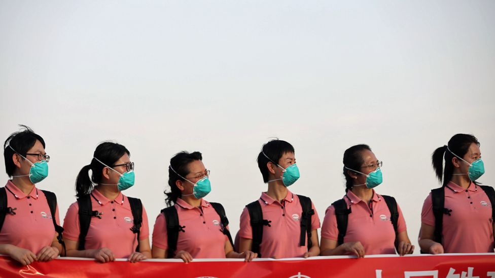 Chinese medics in face masks at the main airport in Abuja, Nigeria - Wednesday 8 April 2020