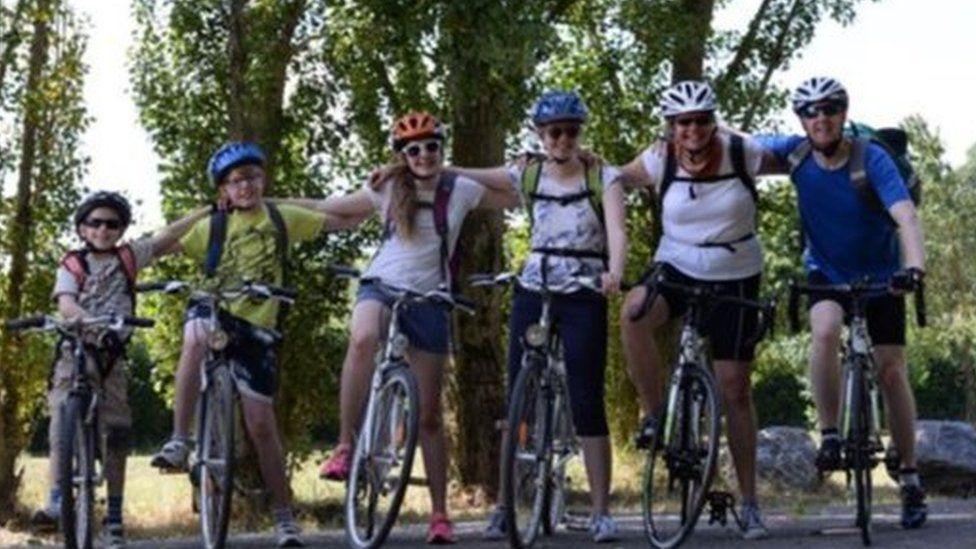 The Simpson family on their bikes