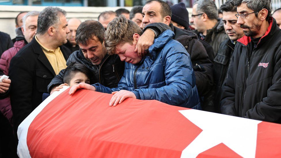 Relatives mourn Ayhan Arik, the travel agent who died at the Istanbul nightclub shooting, 2 January 2016