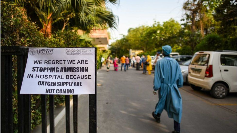 A public notice hangs outside a Delhi hospital notifying shortage of oxygen beds