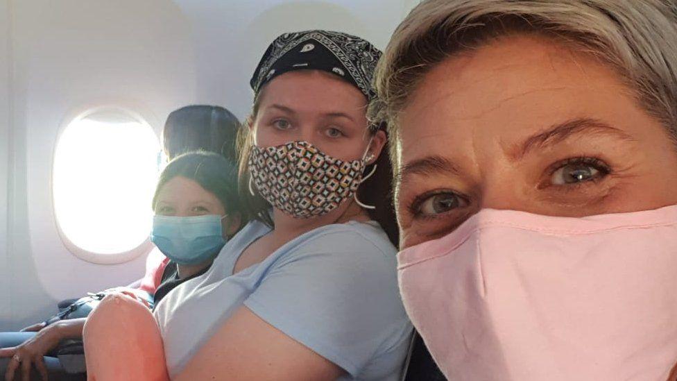 people wearing masks on flight