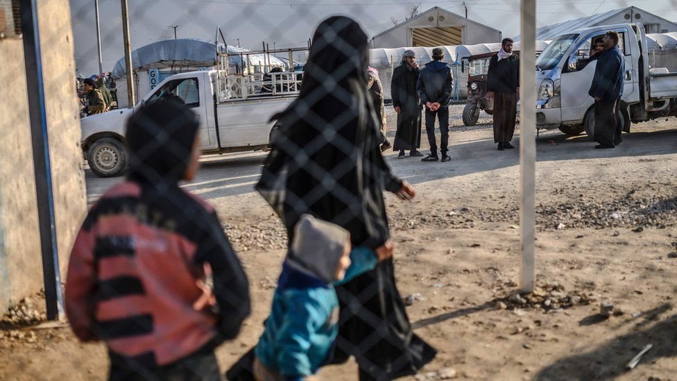 A detained female Islamic State member and her children at the al-Hol camp in north-eastern Syria (17 February 2019)