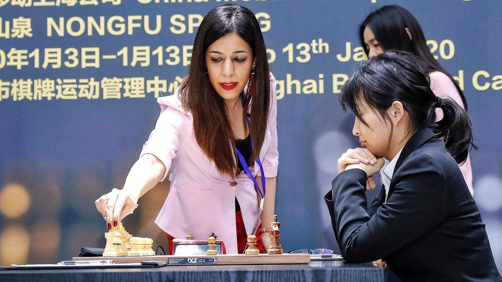 Shohreh Bayat (L) prepares for a match at the 2020 International Chess Federation (FIDE) Women's World Chess Championship in Shanghai, 11 January 2020