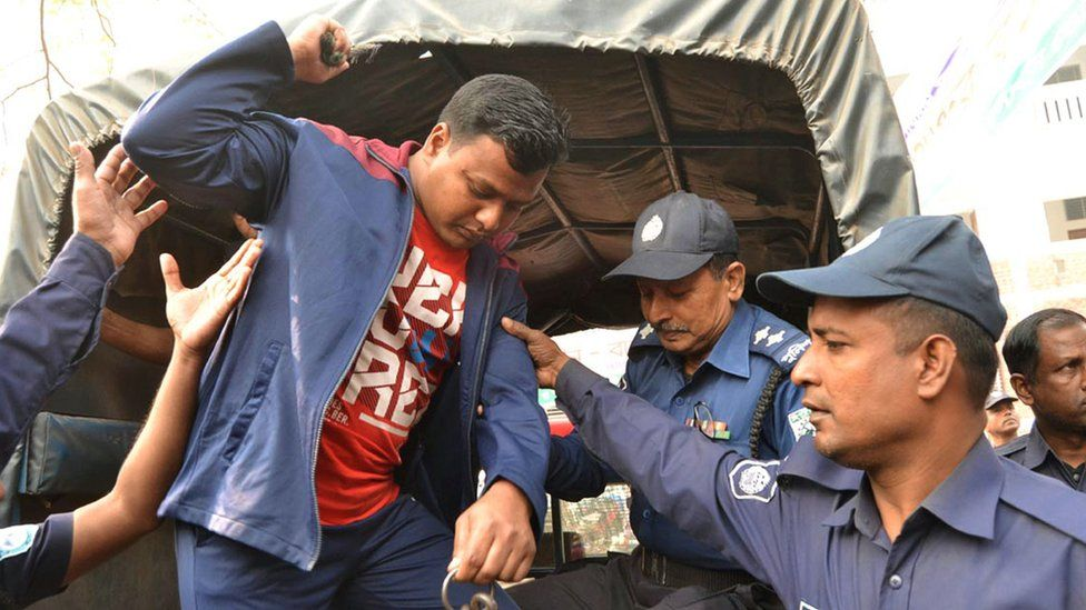 A convicted Islamist militant is escorted by Bangladesh police outside a court in Rangpur on February 28, 2017, after being handed a death sentence over the 2015 murder of a Japanese citizen.