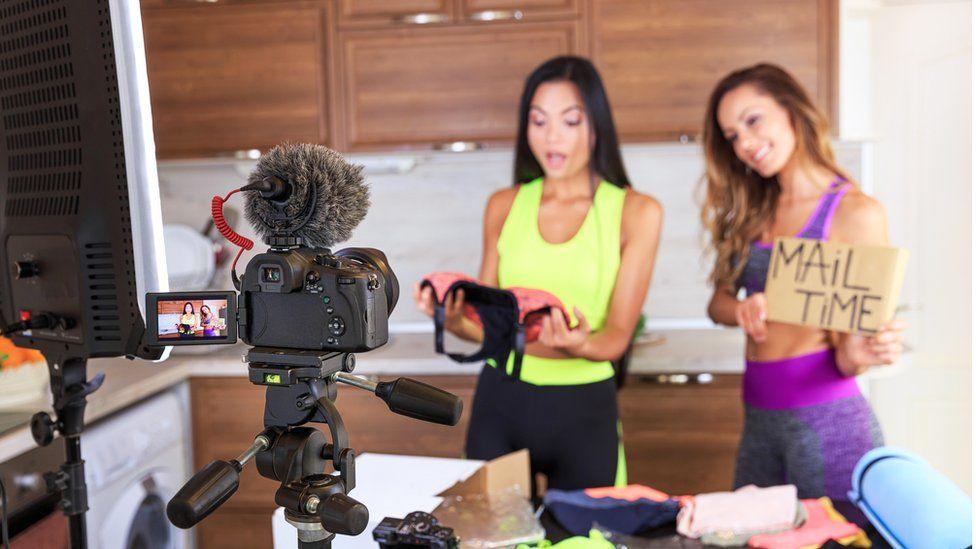 Women recording on camera