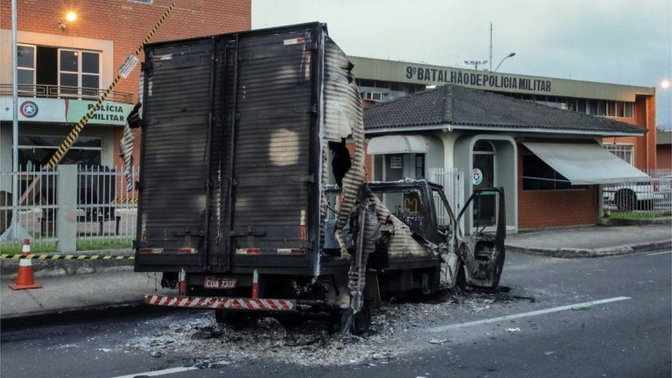 View of a truck set on fire in the aftermath of a bank robbery in Criciuma, Brazil, 01 December 2020.