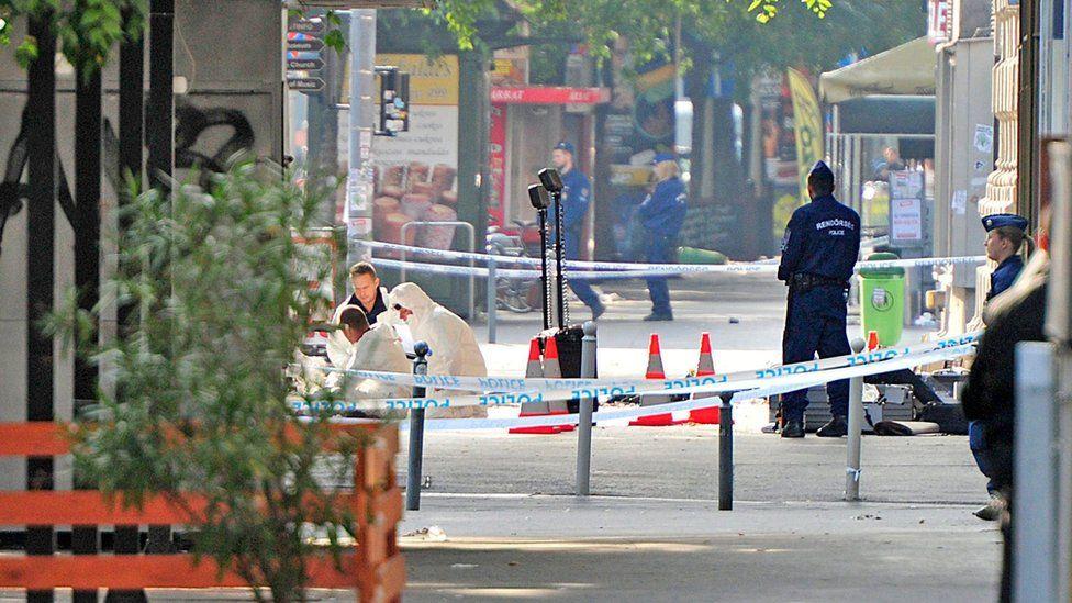 Forensic teams examine the scene of the blast on Sunday, September 25 2016.