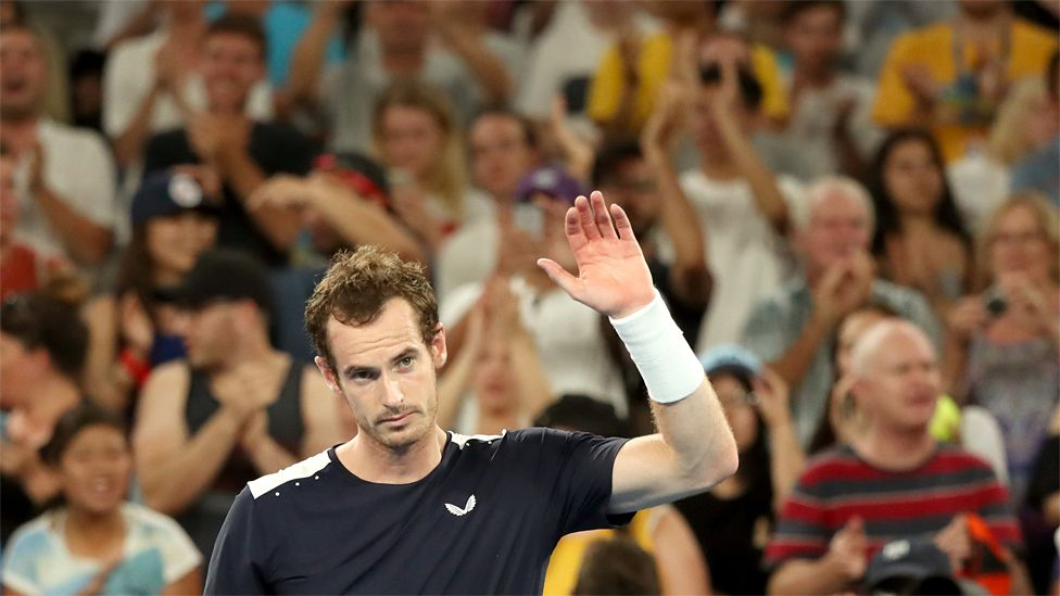 Andy Murray waves to the crowd after losing at the Melbourne Arena