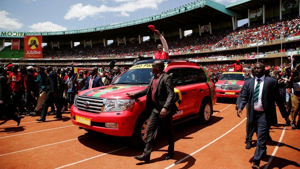Kenya's President Uhuru Kenyatta waves to supporters as he arrives at the Kasarani stadium for the official launch of the Jubilee Party ahead of the 2017 general elections in Kenya's capital Nairobi, September 10, 2016.