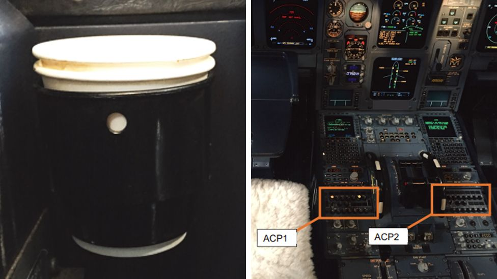 A cup holder (left) and audio control panels (APC) 1 and 2