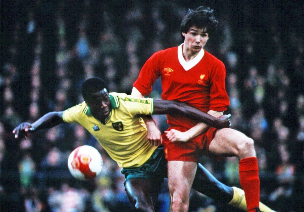 Justin Fashanu and Alan Hansen in match between Norwich and Liverpool in 1980