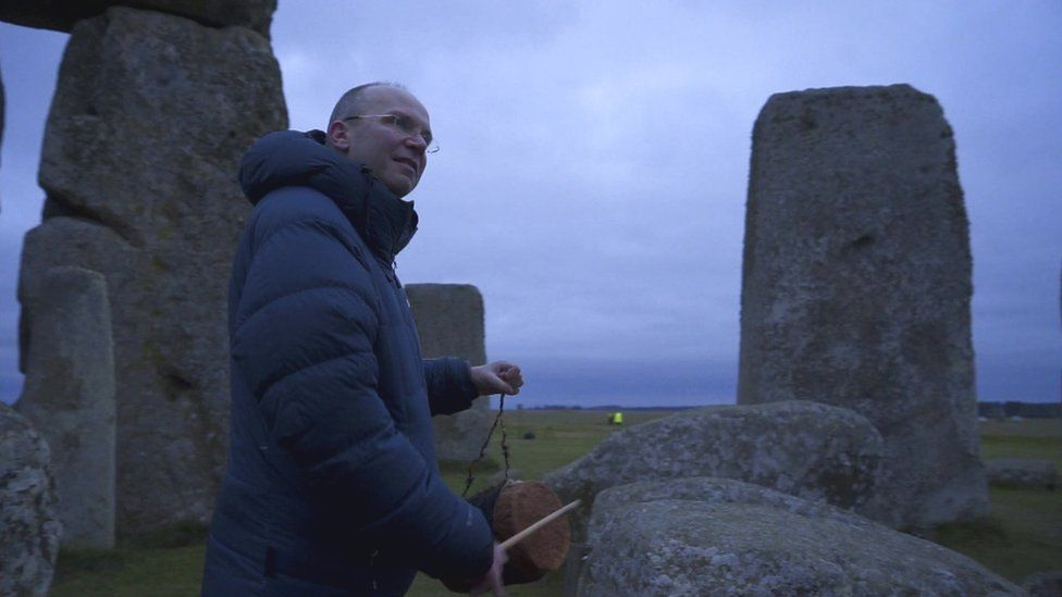 Dr Rupert Till using a drum to demonstrate Stonehenge's acoustics