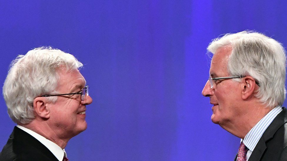 UK Brexit Secretary David Davis and Chief EU Negotiator Michel Barnier face each other